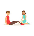 woman bandaging the leg of the injured man first vector image vector image