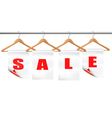 Wooden hangers with sale tags Discount concept vector image