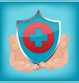 red cross shield hand hold vector image