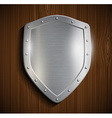 metal shield on a wooden surface vector image