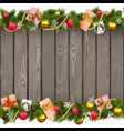 Seamless Christmas Border with Gifts on Old Board vector image vector image
