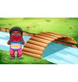 A boy eating watermelon near the wooden bridge