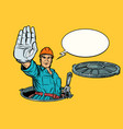 gesture stop plumber in the manhole vector image