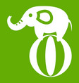elephant balancing on a ball icon green vector image vector image