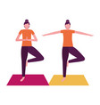women practicing yoga on mat vector image