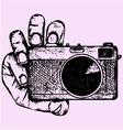 Camera hand vector image vector image