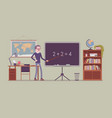 male teacher stands at the blackboard vector image