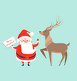santa claus with reindeer icon vector image vector image