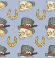 seamless pattern skull in hat and lucky horseshoe vector image