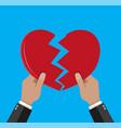 hands tearing apart heart