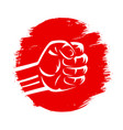 clenched fist on red brush stroke circle hand vector image
