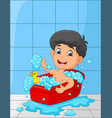 cartoon little boy taking a bath vector image
