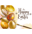 hand painted golden easter eggs and paintbrush vector image