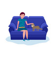 young woman playing with cat sitting on sofa calm vector image vector image