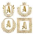 golden vintage monograms set heraldic logos a vector image