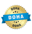 Doha round golden badge with blue ribbon vector image vector image