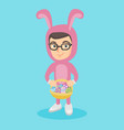 boy in rabbit suit with the basket of easter eggs vector image vector image