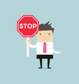 businessman showing stop road sign vector image vector image