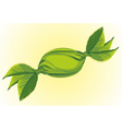 candy wrapped in green leaves vector image