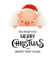 cute pig in santa hat stands behind signboard vector image vector image