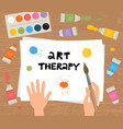 art therapy hands brush paint sheet paper vector image