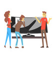 couple choosing wide tv with shop assistant help vector image vector image