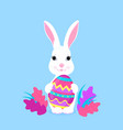cute easter bunny holds paschal egg in its paws vector image vector image