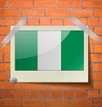 Flags Nigeria scotch taped to a red brick wall vector image