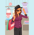 woman shopping inside the clothing store vector image vector image