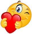 emoticon hugging heart vector image