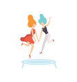 two happy women friends jumping on trampoline vector image vector image