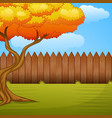 garden background with autumn tree and wooden fenc
