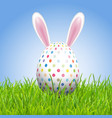 easter background with bunny ears and egg in grass vector image vector image