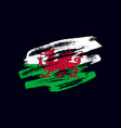 grunge textured welsh flag vector image vector image