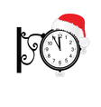 old clock with happy new year hat vector image vector image