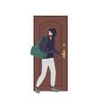 male burglar wearing hoodie trying to unlock door vector image
