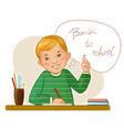 happy small boy at desk vector image vector image
