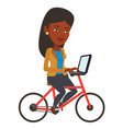 woman riding bicycle and working on a laptop vector image vector image