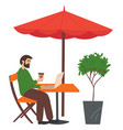 man sitting at a table in a cafe surfing the vector image