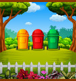 colorfull trashbin with the garden view vector image vector image