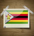 Flags Zimbabwe at frame on wooden texture vector image