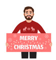 man holds a poster with the words merry christmas vector image vector image