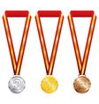 Three medals with gold silver and bronze on red vector image vector image