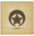 Badge with star on vintage background