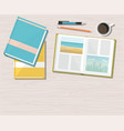 books with pencil and pen isolated on wooden table vector image