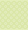 seamless pattern with polka dots on green vector image