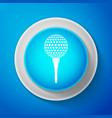 golf ball on tee icon isolated on blue background vector image