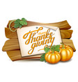 thanksgiving card with wooden banner and pumpkins vector image vector image