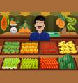 fruit seller in a farmer market vector image