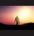 silhouette of a soldier at sunset vector image vector image
